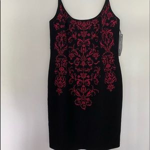 Cocktail/formal red and black dress. Never worn.